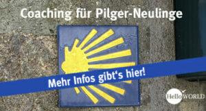 Auf dem Bild sieht man eine gelbe Jakobsmuschel vor blauem Hintergrund, die symbolisch für das kostenlose Pilger-Coaching steht